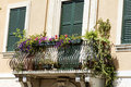 Beautiful vintage italian balcony with pot flowers Royalty Free Stock Photo