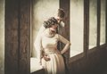Beautiful vintage style couple standing near window Royalty Free Stock Photography