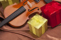 Beautiful violin and presents! Royalty Free Stock Photos