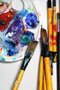 Beautiful vivid art palette mix paintbrushes Royalty Free Stock Photography