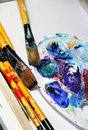 Beautiful vivid art palette mix paintbrushes Stock Photos