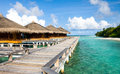 Beautiful vivid over beach with the water villas in indian ocean Stock Photo