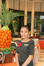 Beautiful waitress at buffet Royalty Free Stock Photo