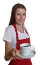 Beautiful waitress with fresh coffee attractive brunette hair offering a cup of on a white background Stock Image
