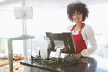 Beautiful waitress posing behind the counter Royalty Free Stock Photo