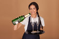 Beautiful waitress pouring champagne Royalty Free Stock Photo