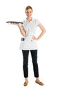 Beautiful waitress with serving tray full length of standing isolated against white background Royalty Free Stock Image