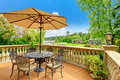 Beautiful walkout deck with antique table set and umbrella amazing view from the Royalty Free Stock Photos
