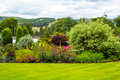 Beautiful walled, victorian garden with variety of flowers and trees Royalty Free Stock Photo