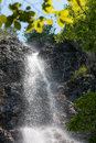Beautiful waterfall falling down rocks in the forest Stock Images