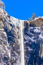 Beautiful Waterfall with icy mountains in Yosemite Royalty Free Stock Photo