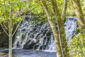Beautiful waterfall in the trees from river arenteiro near spa of carballino orense spain Royalty Free Stock Image