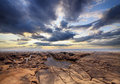 Beautiful waterscape with rocks on foreground endless view stones under cloudy sky Royalty Free Stock Image