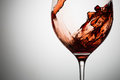 Beautiful waves of red wine in glass closeup Royalty Free Stock Photo