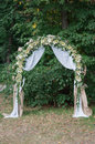 Beautiful wedding arch for the ceremony of flowers Royalty Free Stock Photo