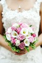 Beautiful wedding bouquet of pink roses in the hands of the bride Royalty Free Stock Photo