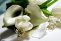 Beautiful wedding bouquet of white callas and tulips lying on the table Royalty Free Stock Images