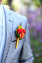 Beautiful wedding boutonniere at groom's costume Stock Photo