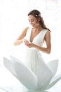 Beautiful wedding bride in a white dress in a romantic scenery Stock Photography