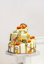 Beautiful wedding cake in orange and creme, with pumpkin Stock Photos
