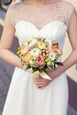 Beautiful wedding colorful nosegay of ranunculus in brides hands Royalty Free Stock Image