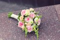 Beautiful wedding colorful nosegay on the stone of pink and peach roses Royalty Free Stock Photos