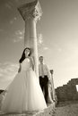 Beautiful wedding couple bride and groom near greece column in the ancient city black and white sepia Royalty Free Stock Images