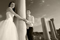 Beautiful wedding couple bride and groom near greece column in the ancient city black and white sepia Stock Photo