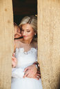 Beautiful wedding couple in doorway Royalty Free Stock Photo