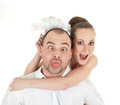 Beautiful wedding couple making funny facesover white background Royalty Free Stock Photo