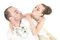 Beautiful wedding couple trying to kiss each othere over white background Stock Images
