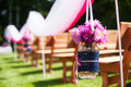 Beautiful wedding flower arrangement of seats on ceremony Royalty Free Stock Photo