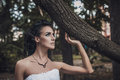 Beautiful wedding style brunette bride woman in wood park photo Royalty Free Stock Photos