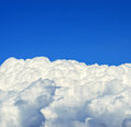 Beautiful white clouds beneath blue sky background this image represents Stock Photos