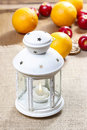 Beautiful white lantern on jute table cloth colorful fruits in the background Royalty Free Stock Photos
