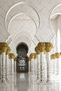 Beautiful white muslim church interior passageway bright and gold columns floral ornaments Royalty Free Stock Photography
