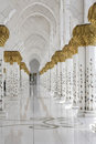 Beautiful white muslim church interior passageway bright and gold columns floral ornaments Stock Photography