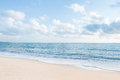 Beautiful white sand beach and ocean waves with clear blue sky