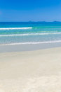 A beautiful white sand beach in vietnam with small off shore islands on the horizon Stock Photo