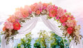 Beautiful white wedding arch outdoors