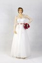 Beautiful white wedding gown n mannequins Stock Photo
