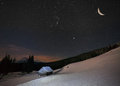 Beautiful winter landscape in the mountains to night with stars and moon Royalty Free Stock Images