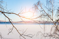Beautiful winter landscape with snow covered lake and trees small depth of sharpness Stock Photo