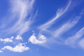 Beautiful wispy clouds over clear blue sky Royalty Free Stock Photography