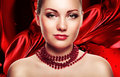 Beautiful woman with accessorize on red fabric background Stock Photo