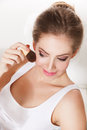Beautiful woman applying blush portrait of a finishing her makeup Stock Images