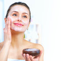 Beautiful woman applying facial mask Royalty Free Stock Photo