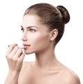 Beautiful woman applying hygienic lip balm. Royalty Free Stock Photo