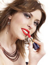 Beautiful woman applying lipstick. Royalty Free Stock Images