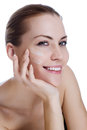 Beautiful woman applying moisturizer cream Royalty Free Stock Photography